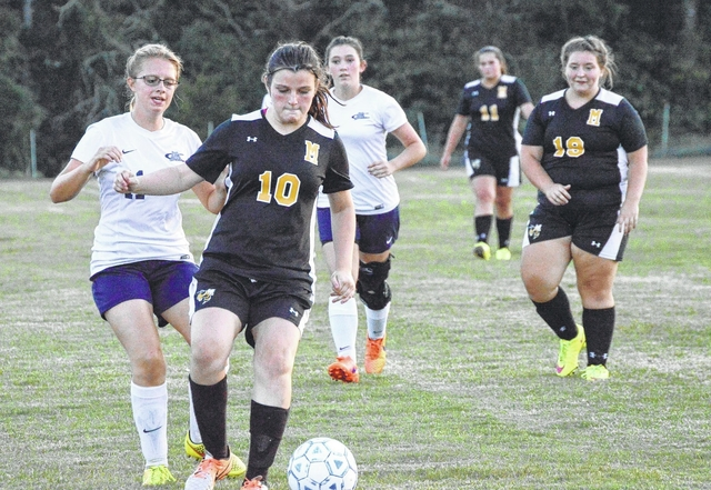 Trinity Hardin regains possession of the ball during Middlesboro's game against Claiborne on Thursday. The match ended in a 1-1 draw.