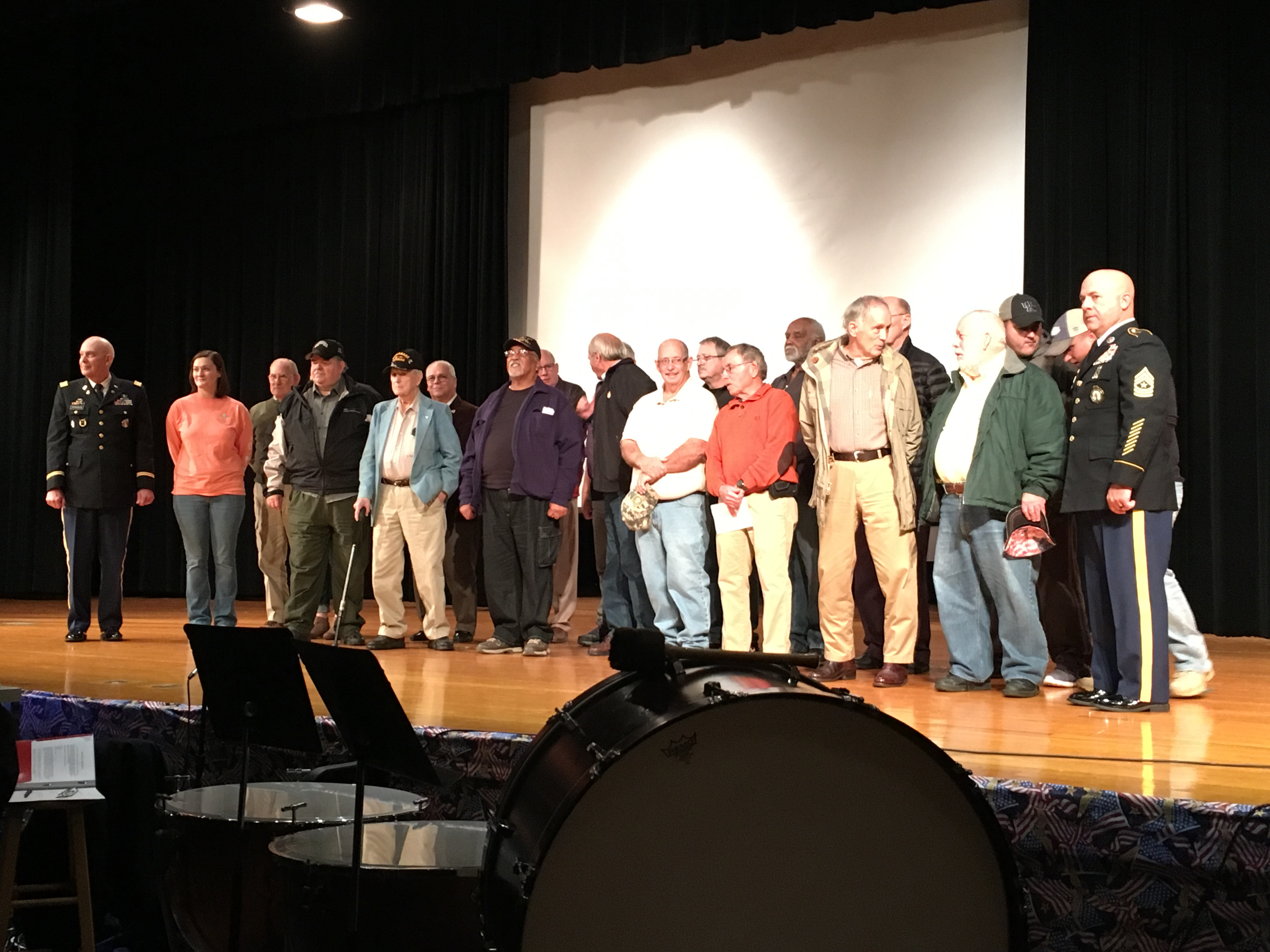 Veterans pose for a picture following the program at Central Arts Auditorium.